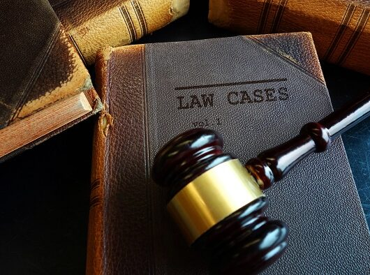 Law Cases law books and legal gavel